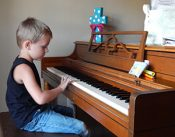 boy-practicing-piano